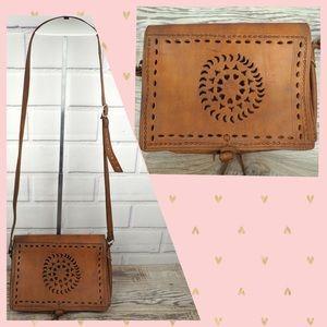Handmade tooled tan leather crossbody flap bag